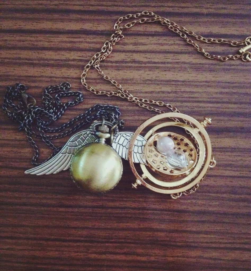 giratempo, golden snitch, harry potter and hermione granger