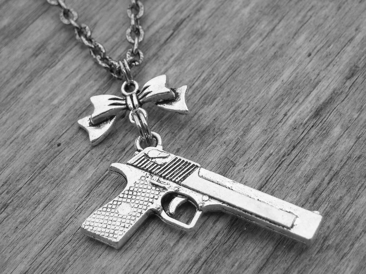 bow, bows, cowgirl, cute, gun, guns, handgun, heavy metal, hunter, hunting, jewelry, metal, necklace, pistol, punk, punk rock, revolver, rock, rock and roll, rock n roll, rocker, shotgun, silver