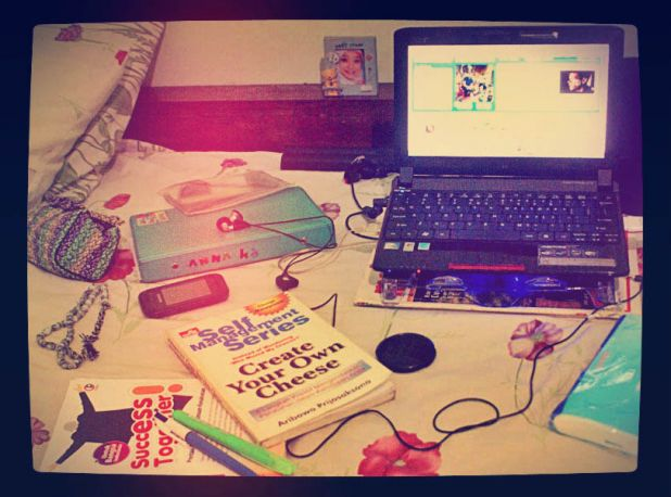 around me, in my bed, my pc, books, with music