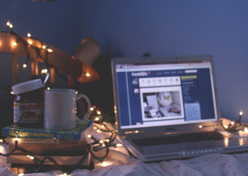 bed, books, laptop, lights, nutella
