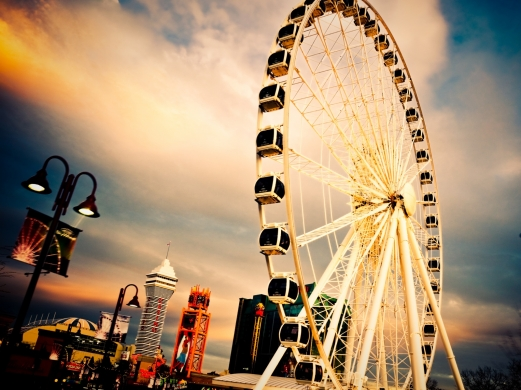 carousel, ferris wheel, a city, evening, dusk
