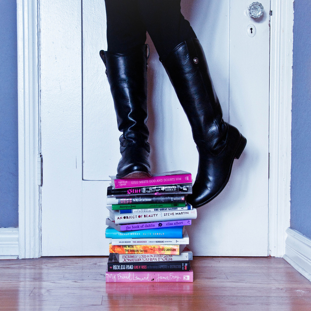 self portrait, books, riding boots, square format