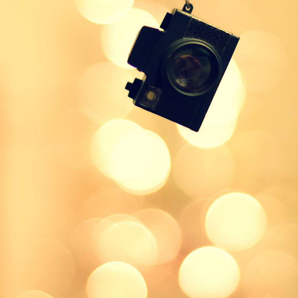 square, camera, it is a keychain that makes a shutter sound and flashes, it is kind of cute