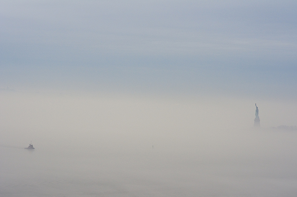 Statue of Liberty, fog, tugboat, NY Harbor