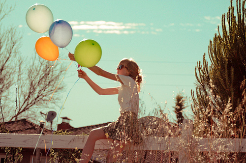 balons, blond hair, blue, color, cute, girl, gras, green, happy, houses, nature, orange, skirt, summer, sun, sunglasses, white