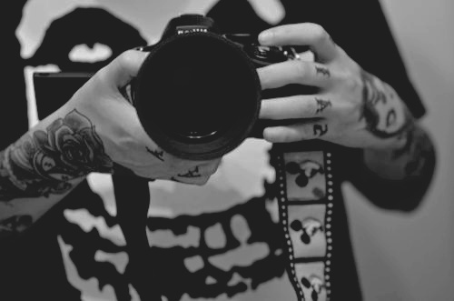 arm, arm tattoo, arms, b&w, black and white, camera, hand, hand tattoo, hands, misfits, t-shirt, t-shirt band, t-shirt misfits, tattoo, tattooed, tattoos