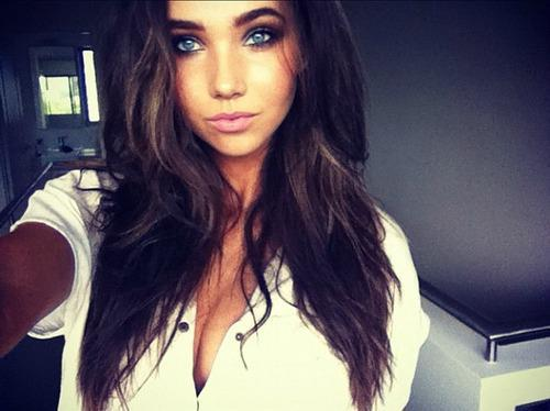 Firmly girl with brown hair and blue eyes the