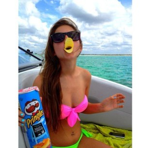 awesome, bathing suit, blue, boat, brown, clouds, cool, fun, girl, green, hair, long, mouth, ocean, phone, pink, pringles, sky, sunglasses, water